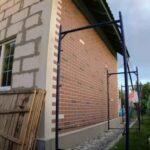 Декоративная отделка фасада дома с имитацией кирпичной кладки